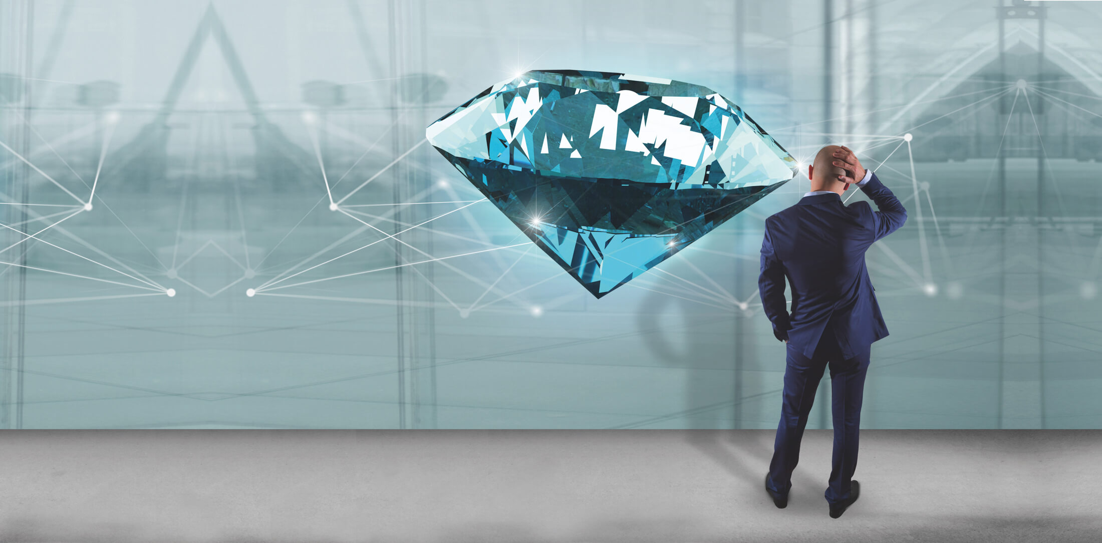 Businessman in front of a wall with diamond shinning in front